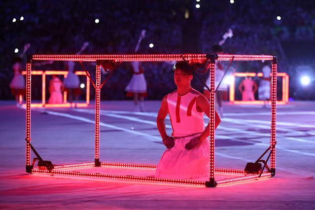 <p>Dancers perform during the 'Love Sport Tokyo 2020' segment during the Closing Ceremony on Day 16 of the Rio 2016 Olympic Games at Maracana Stadium on August 21, 2016 in Rio de Janeiro, Brazil. (Photo by Cameron Spencer/Getty Images) </p>
