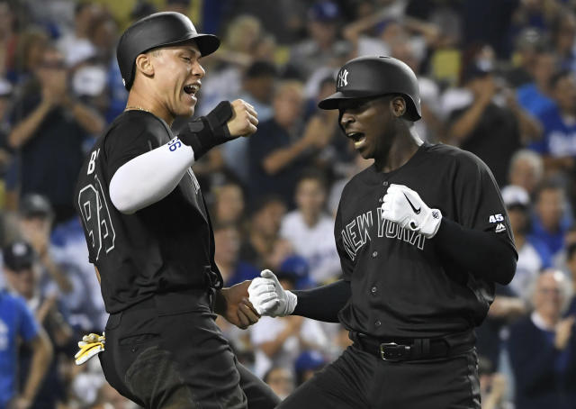 Aaron Judge #99 of the New York Yankees congratulates Didi Gregorius #18 after he hit a grand slam home run against Hyun-Jin Ryu #99 of the Los Angeles Dodgers (Photo by John McCoy/Getty Images)
