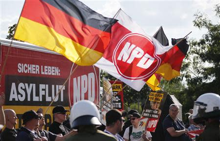 Far-right National Democratic Party (NPD) supporters protest against a refugee asylum in the Hellersdorf district of Berlin, in this August 24, 2013 file picture. REUTERS/Fabrizio Bensch/Files