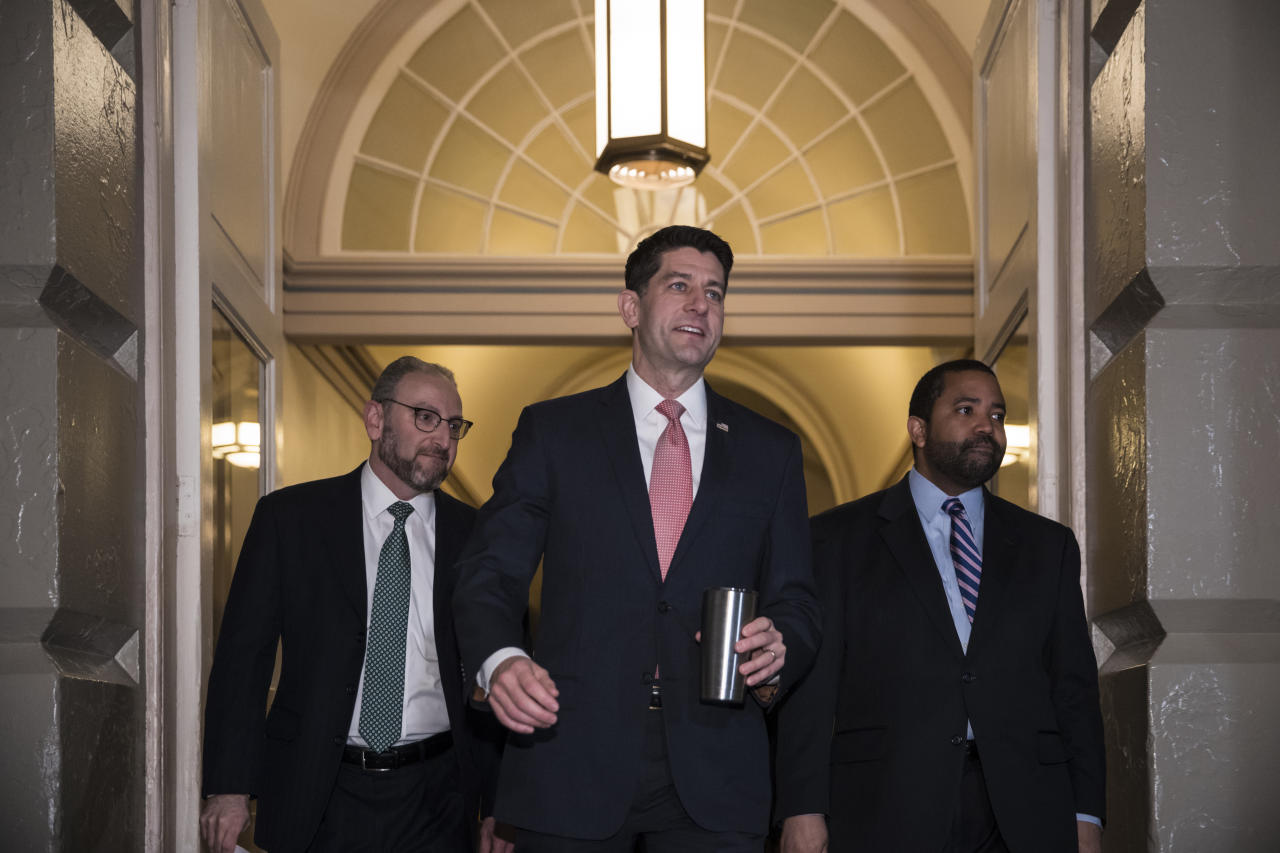 Speaker of the House Paul Ryan, R-Wis., arrives for a meeting of fellow Republicans on the first morning of a government shutdown after a divided Senate rejected a funding measure, at the Capitol in Washington, Saturday, Jan. 20, 2018. (AP Photo/J. Scott Applewhite)