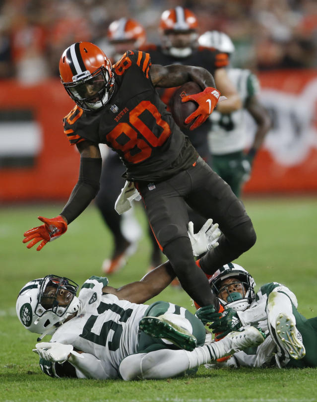Cleveland Browns wide receiver Jarvis Landry (80) steps over New York Jets linebacker Brandon Copeland during the first half of an NFL football game, Thursday, Sept. 20, 2018, in Cleveland. (AP Photo/Ron Schwane)