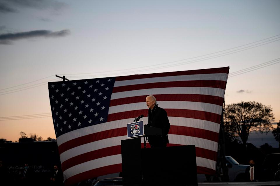 """Biden campaigns at a drive-in rally in Detroit on Oct. 16<span class=""""copyright"""">Jim Watson—AFP/Getty Images</span>"""