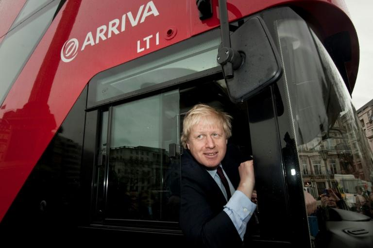 As London mayor, Johson oversaw a number of transport projects, such as a remake of the city's iconic red buses (AFP Photo/BEN STANSALL)