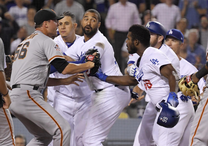 Los Angeles Dodgers outfielder Yasiel Puig (front right) was suspended for his role in Tuesday's brawl with the San Francisco Giants. (AP)