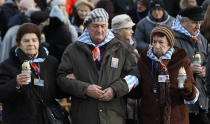 File - In this Sunday, Jan. 27, 2019 file photo, survivors of the Nazi death camp Auschwitz arrive for a commemoration ceremony on International Holocaust Remembrance Day at the International Monument to the Victims of Fascism inside Auschwitz-Birkenau in Oswiecim, Poland. Hundreds of Holocaust survivors in Austria and Slovakia are getting vaccinated against the coronavirus exactly 76 years after the liberation of the Nazi's Auschwitz death camp. More than 400 Austrian survivors were invited to get the vaccine at Vienna's biggest mass vaccination center on International Holocaust Remembrance Day on Wednesday Jan. 27, 2021. (AP Photo/Czarek Sokolowski)