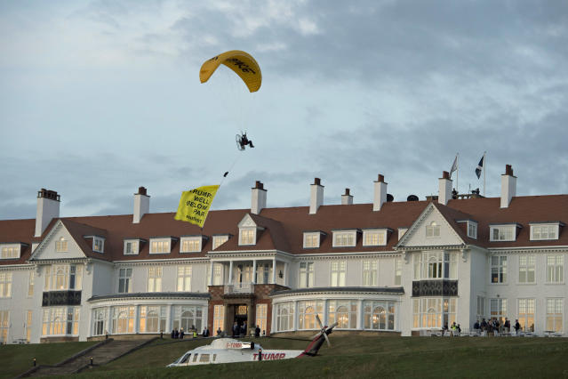 """<p>A Greenpeace protester flying a microlight paraglider-style aircraft passes over President Trump's golf resort in Turnberry, South Ayrshire, Scotland, on Friday, July 13, 2018, with a banner reading """"Trump: Well Below Par,"""" shortly after the president arrived at the hotel. Scottish police said the protester breached a no-fly zone over Turnberry hotel and committed a criminal offense. (Photo: John Linton/PA via AP) </p>"""