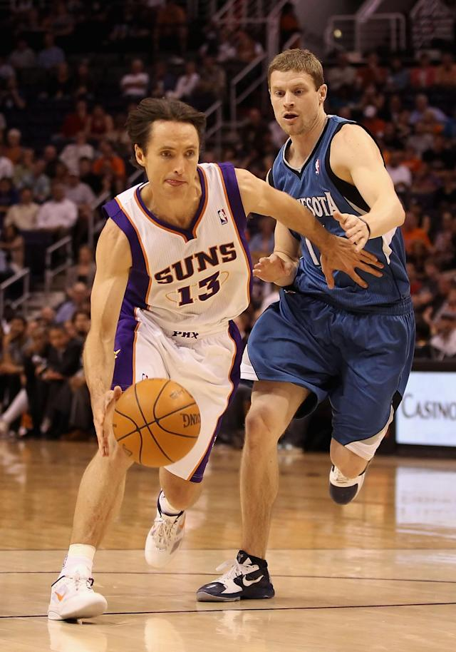 PHOENIX, AZ - MARCH 12: Steve Nash #13 of the Phoenix Suns drives the ball past Luke Ridnour #13 of the Minnesota Timberwolves during the NBA game at US Airways Center on March 12, 2012 in Phoenix, Arizona. The Timberwolves defeated the Suns 127-124. NOTE TO USER: User expressly acknowledges and agrees that, by downloading and or using this photograph, User is consenting to the terms and conditions of the Getty Images License Agreement. (Photo by Christian Petersen/Getty Images)