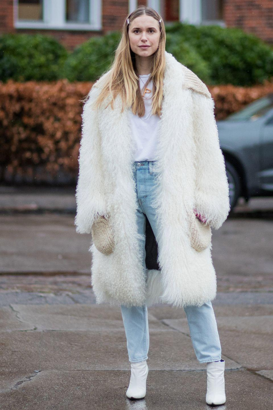 <p>Black leather tends to look a little harsh next to a light-wash denim so make like Pernille Teisbaek and team it with white booties instead.</p>
