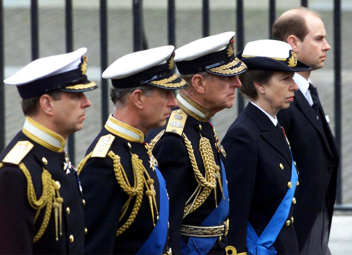 FILE - In this Tuesday, April 9, 2002 file photo, members of the British royal family follow the coffin of the Queen Mother en route to her funeral in Westminster Abbey in London. From left: Prince Andrew, Prince Charles, Prince Philip, Princess Anne and Prince Edward. Buckingham Palace officials say Prince Philip, the husband of Queen Elizabeth II, has died, it was announced on Friday, April 9, 2021. He was 99. Philip spent a month in hospital earlier this year before being released on March 16 to return to Windsor Castle. Philip, also known as the Duke of Edinburgh, married Elizabeth in 1947 and was the longest-serving consort in British history. (AP Photo/Santiago Lyon, File)