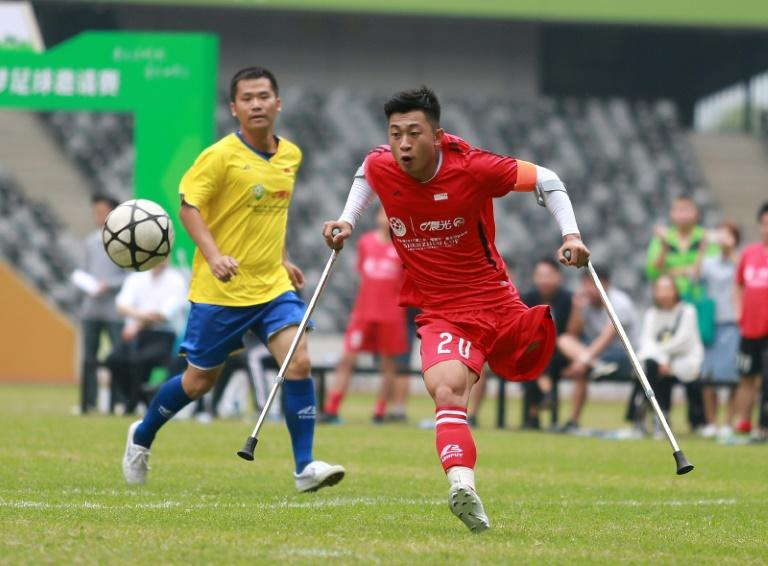 He Yiyi kicks the ball during a football match with a local team in Guangzhou, Guangdong province, on November 12, 2017