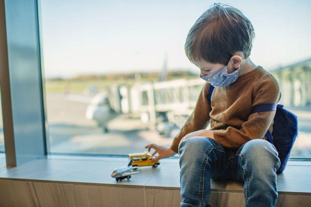 Little boy traveling by plane (Photo: ArtMarie via Getty Images)