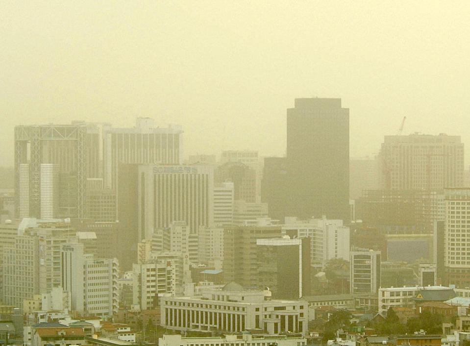 The Seoul skyline shrouded by yellow dust storms blowing in from China's Gobi Desert.
