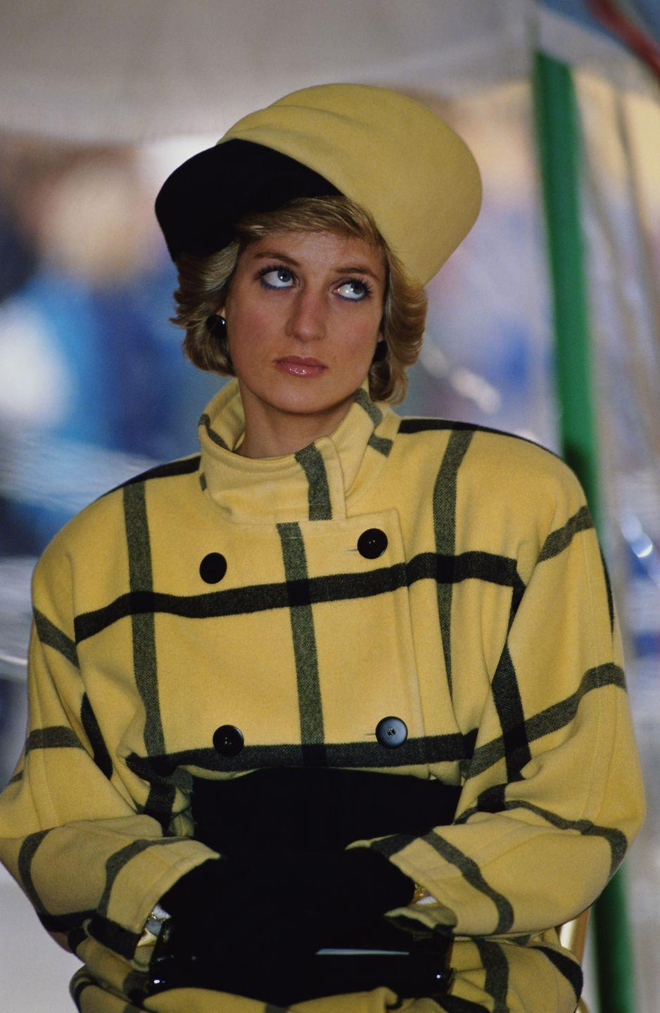 <p>The royal family loves their plaid. Princess Diana coordinated her look with a hat by Philip Somerville. </p>