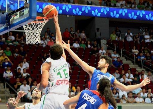 Iran's Hamed Haddadi (L) goes up to the hoop against Taiwan in their men's Asia Championships basketball game in Manila on August 10, 2013. Iran won 79-60
