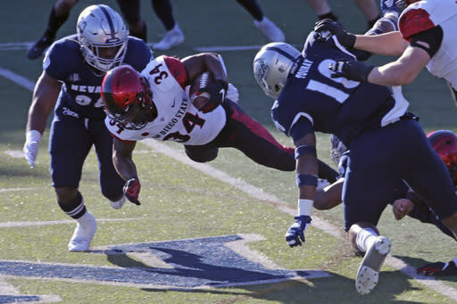 San Diego State running back Greg Bell runs for a first down against Nevada during the first half of an NCAA college football game Saturday, Nov. 21, 2020, Reno, Nev. (AP Photo/Lance Iversen)