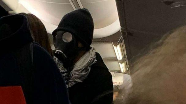 PHOTO: An unidentified man wearing a gas mask is seen aboard an American Airlines flight from Dallas to Houston, Jan. 30, 2020. (@ThePlatypusesTX)