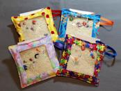 <p>Take your sensory toys on the go with these cute <span>Stitched4UByTrippy2 I Spy Bag</span> ($14), made with rice, toys, and letters inside an easy-to-hold fabric bag.</p>