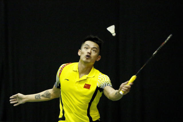FILE - A Wednesday, Jan. 17, 2018 file photo of two-time Olympic champion, Lin Dan of China returning a shot to Ihsan Maulana Mustofa of Indonesia during the first round of the men's singles match in the 2018 Malaysia Masters badminton tournament in Kuala Lumpur, Malaysia. Badminton greats Lin Dan and Lee Chong Wei look likely to contest a 40th instalment of their rivalry at the All England Championships starting on Wednesday. (AP Photo/Sadiq Asyraf, File)