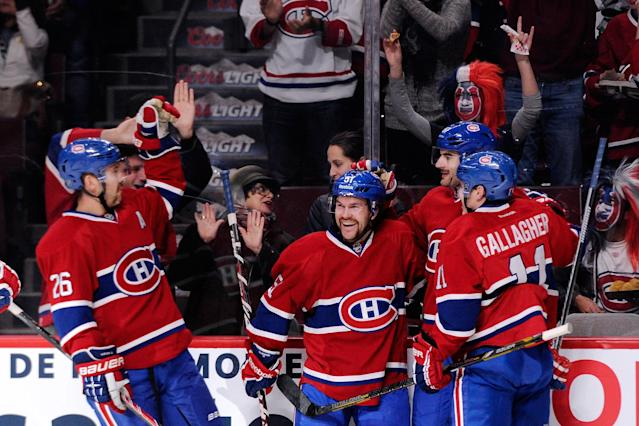 MONTREAL, QC - NOVEMBER 23: Max Pacioretty #67 of the Montreal Canadiens celebrates his second period goal with teammates during the NHL game Pittsburgh Penguins at the Bell Centre on November 23, 2013 in Montreal, Quebec, Canada. (Photo by Richard Wolowicz/Getty Images)