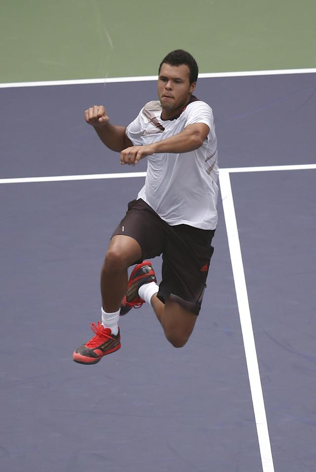 Jo-Wilfried Tsonga of France jumps in celebration after defeating Florian Mayer of Germany during the singles quarterfinal match of the Shanghai Masters tennis tournament at Qizhong Forest Sports City Tennis Center in Shanghai, China, Friday, Oct. 11, 2013. Tsonga won 6-2, 6-3. (AP Photo/Eugene Hoshiko)