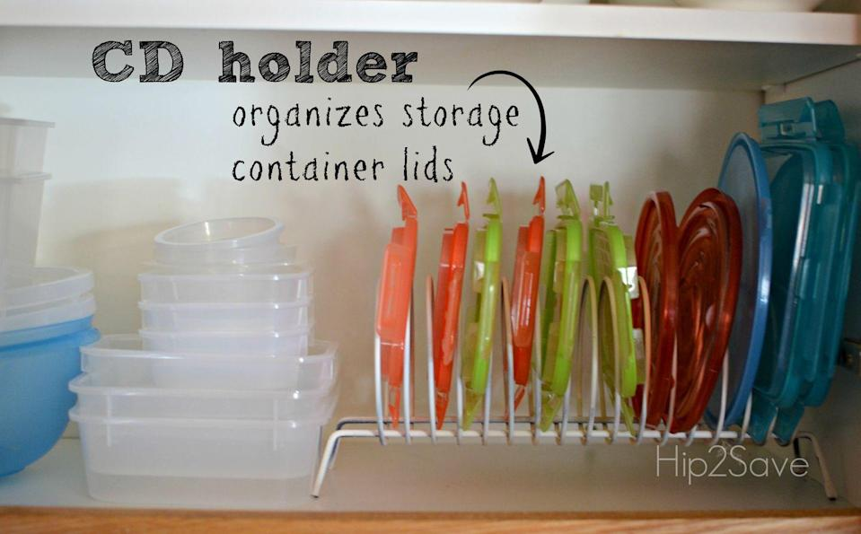 """<p>We bet the compact disc holder you bought in the '90s is now collecting dust in your attic. Give this outdated organizer a helpful new purpose by using it to store plastic lids.</p><p><a href=""""http://hip2save.com/2014/02/13/great-ideas-series-re-purposing-and-re-using-everyday-items-in-the-kitchen/"""" rel=""""nofollow noopener"""" target=""""_blank"""" data-ylk=""""slk:See more at Hip 2 Save »"""" class=""""link rapid-noclick-resp""""><em>See more at Hip 2 Save »</em></a></p>"""