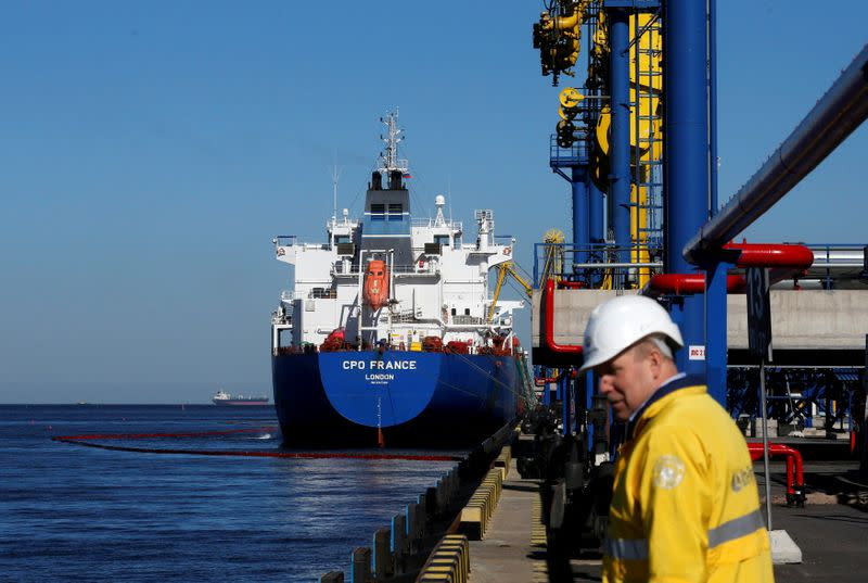 FILE PHOTO: Oil is pumped into an oil tanker at the Ust-Luga oil products terminal in the settlement of Ust-luga