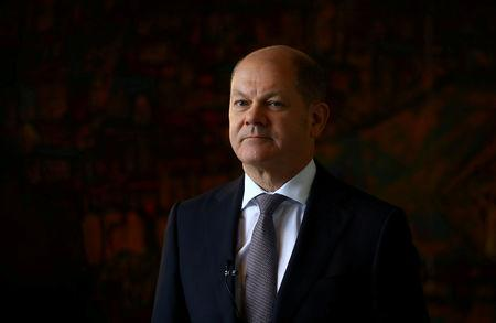 FILE PHOTO: German Finance Minister Olaf Scholz attends a Reuters interview in Berlin