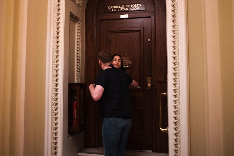 Roberts kisses Ocasio-Cortez goodbye outside of the Democratic members cloak room. There is a snack bar, but he doesn't like the coffee.