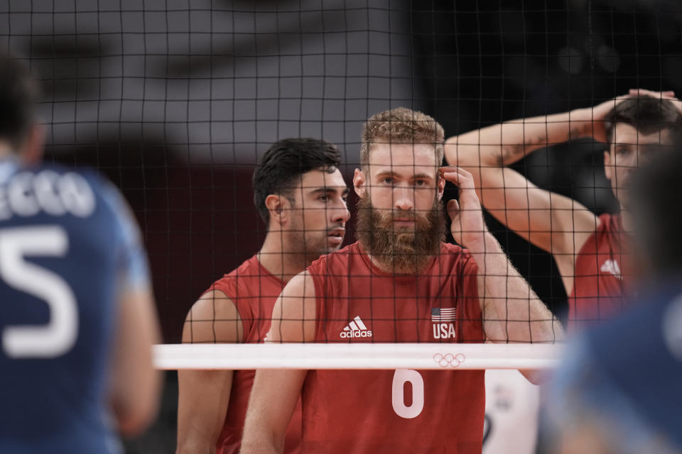 Mitchel Stahl, of the United States, takes his position at the net during a men's volleyball preliminary round pool B match against Argentina, at the 2020 Summer Olympics, early Monday, Aug. 2, 2021, in Tokyo, Japan. (AP Photo/Manu Fernandez)
