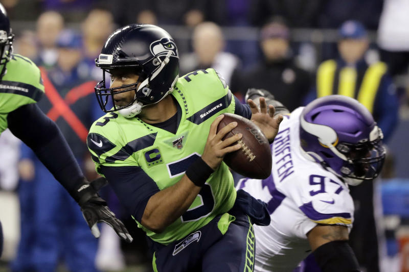 Russell Wilson's magic backfired with a bizarre pick six against the Vikings. (Ted S. Warren/AP)