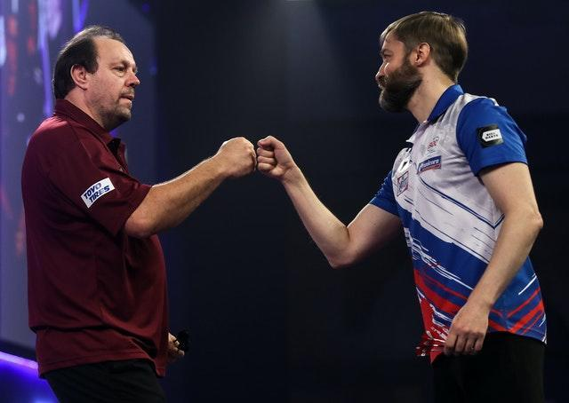 Lowe, left, defeated Dmitriy Gorbunov in the PDC World Championship first round (Kieran Cleeves/PA)