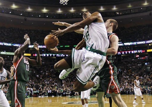 Boston Celtics power forward Sean Williams, center, gets past Milwaukee Bucks forward Jon Leuer, right, on a drive to the basket during the second quarter of an NBA basketball game in Boston, Thursday, April 26, 2012. (AP Photo/Charles Krupa)