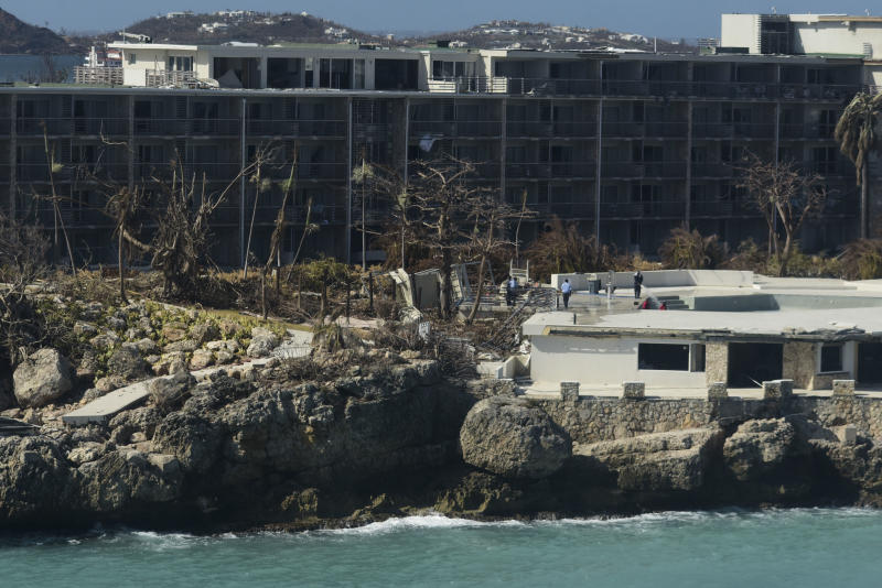 A damaged hotel stands after the passage of Hurricane Irma, close to the airport, in Phillipsburg, St. Martin, Monday, September 11, 2017. Irma cut a path of devastation across the northern Caribbean, leaving thousands homeless after destroying buildings and uprooting trees. (AP Photo/Carlos Giusti)