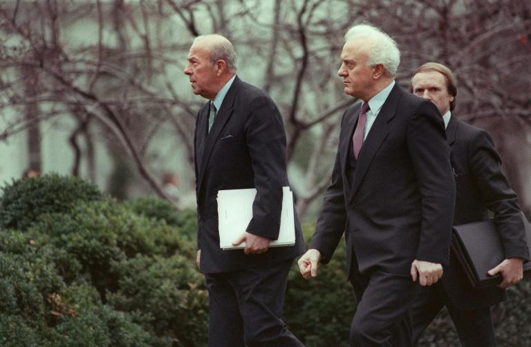 George Shultz (L), then the US secretary of state, walks into the White House with Soviet Foreign Minister Eduard Shevardnadze in December 1987