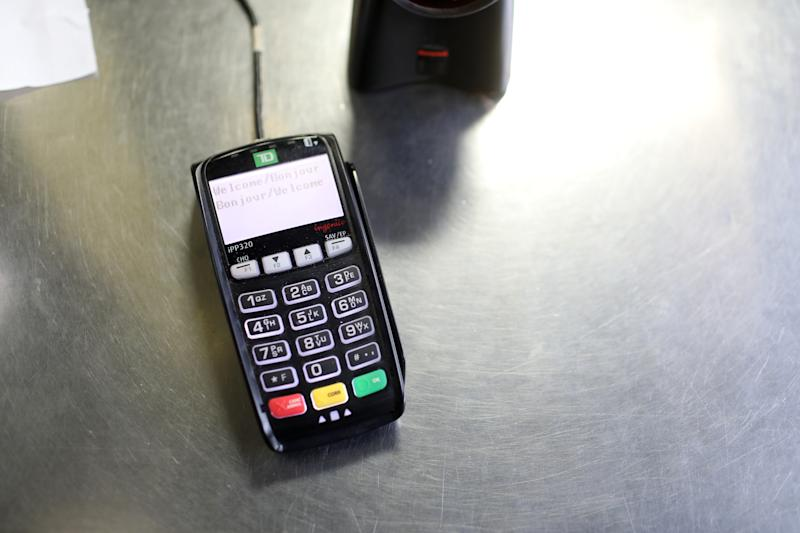 Point of Sale or debit/ credit machine. (Rene Johnston/Toronto Star via Getty Images)