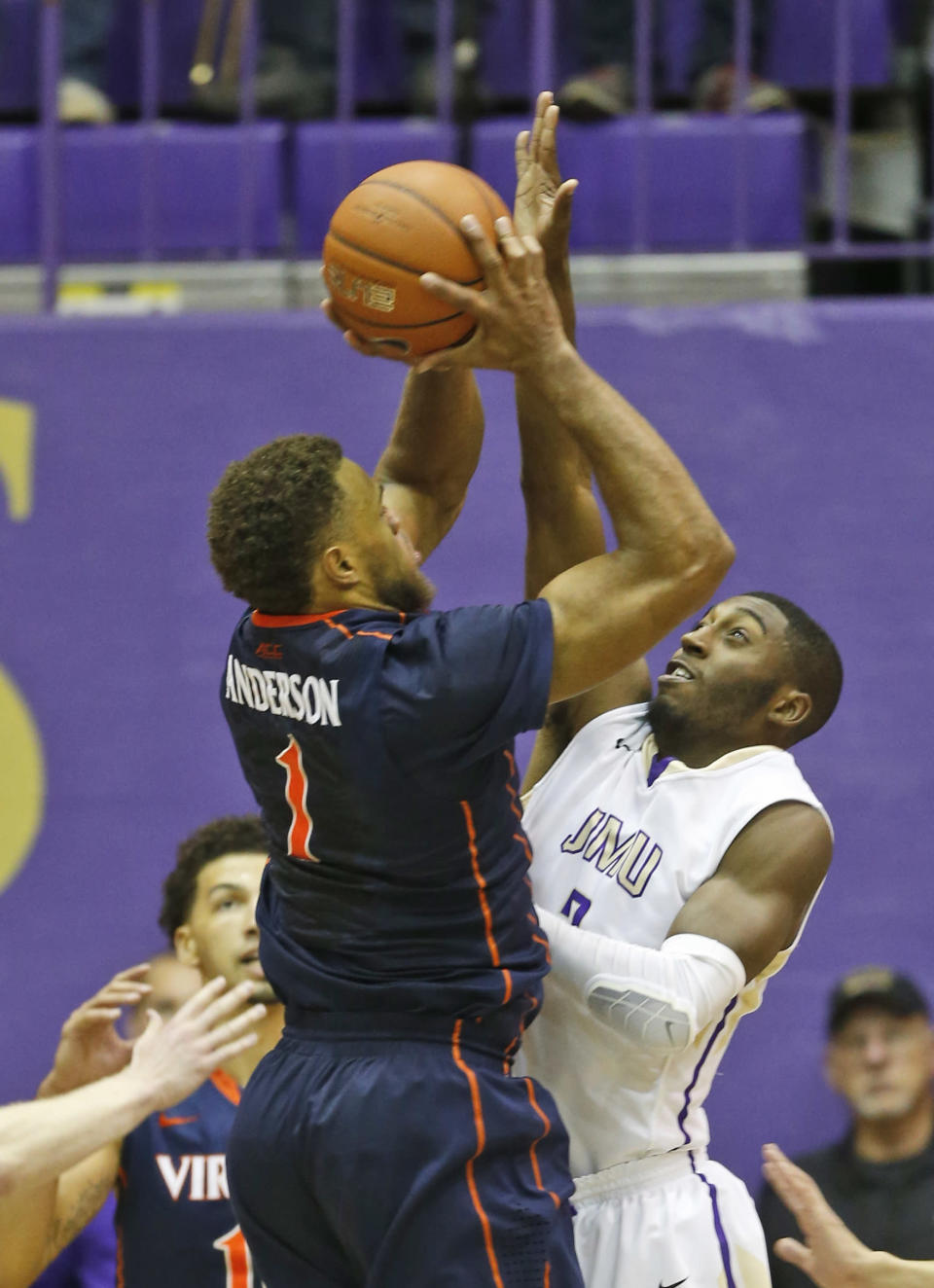 Virginia guard Justin Anderson (1) takes a shot over James Madison guard Ron Curry, right, during the second half of an NCAA college basketball game in Harrisonburg, Va., Friday, Nov. 14, 2014. Virginia won 79-51. (AP Photo/Steve Helber)
