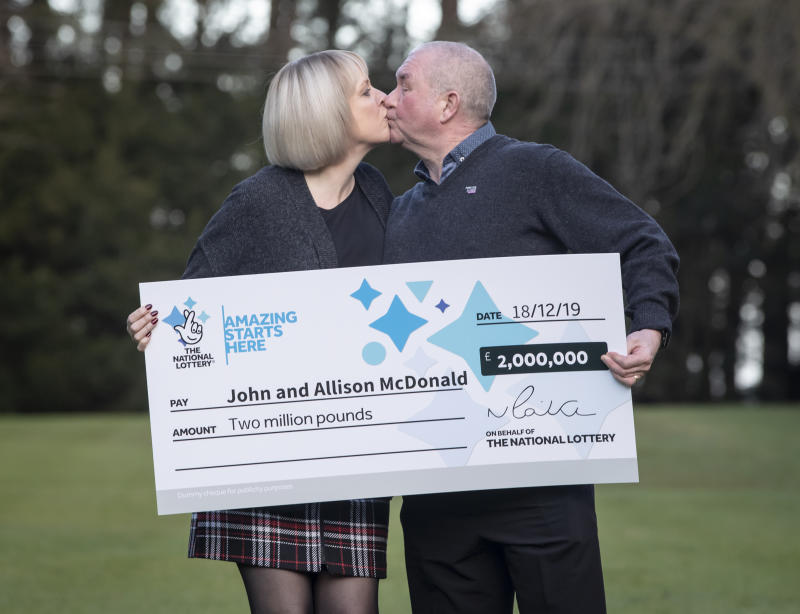 John and Allison McDonald, from Stockton On Tees, celebrating their �2 million Lotto jackpot win at Crathorne Hall, North Yorkshire.