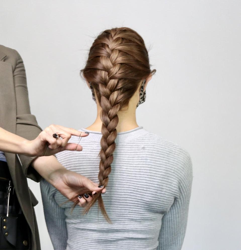<p>Secure the end of the braid with a clear elastic or rubber band, leaving a half inch or so of hair poking out at the ends. </p>