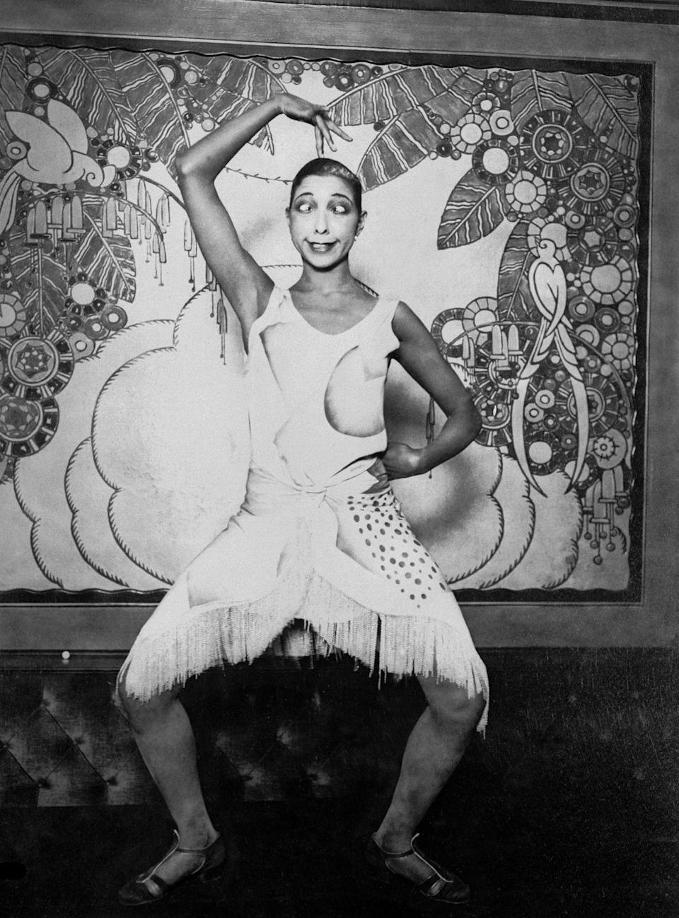 """<p>In a 1926 performance at the popular concert hall Folies Bergére, Baker <a href=""""https://www.biography.com/performer/josephine-baker"""" rel=""""nofollow noopener"""" target=""""_blank"""" data-ylk=""""slk:wore a banana skirt during La Folie du Jour"""" class=""""link rapid-noclick-resp"""">wore a banana skirt during <em>La Folie du Jour</em></a>. The outfit became synonymous with Baker's on-stage persona and one of the most iconic wardrobe choices of the era.</p>"""