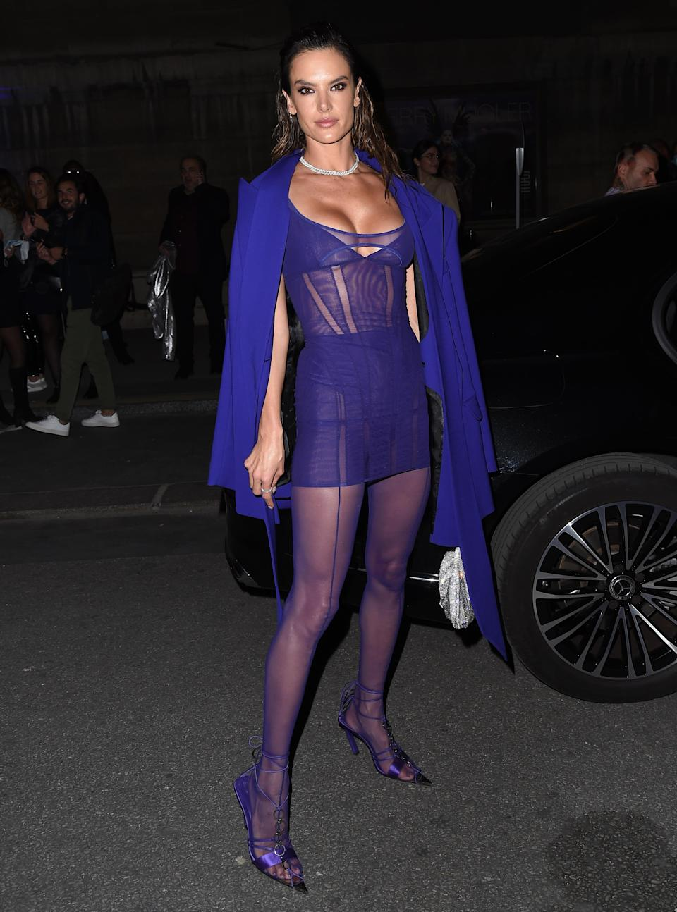 """Alessandra Ambrosio arrives at a photocall for """"Thierry Mugler : Couturissime"""" at Paris Fashion Week 2021. - Credit: SplashNews.com"""