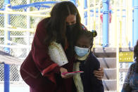 Meghan, the Duchess of Sussex, hugs a second grade student who present her with a pair heart, when she and Prince Harry, visited P.S. 123, the Mahalia Jackson School, in New York's Harlem neighborhood, Friday, Sept. 24, 2021. (AP Photo/Richard Drew)