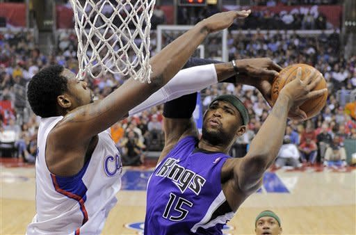 Sacramento Kings forward DeMarcus Cousins, right, puts up a shot as Los Angeles Clippers center DeAndre Jordan defends during the first half of their NBA basketball game, Saturday, April 7, 2012, in Los Angeles. (AP Photo/Mark J. Terrill)