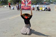A protester holds up a sign calling for the release of detained Myanmar civilian leader Aung San Suu Kyi during a demonstration against the military coup