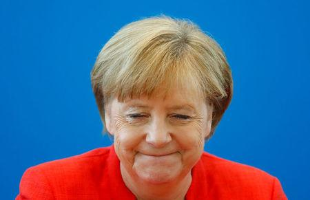 German Chancellor Angela Merkel reacts as she attends the board meeting of Germany's Christian Democratic Union (CDU) in Berlin, Germany, June 18 2018. REUTERS/Hannibal Hanschke