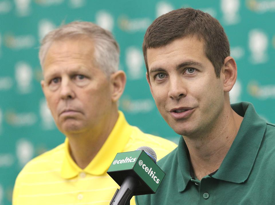WALTHAM, MA - JUNE 30: Danny Ainge, left, president of basketball operations, and head coach Brad Stevens at the press conference. The Boston Celtics introduce their new draft picks, Marcus Smart and James Young, on Monday, June 30, 2014. (Photo by Pat Greenhouse/The Boston Globe via Getty Images)