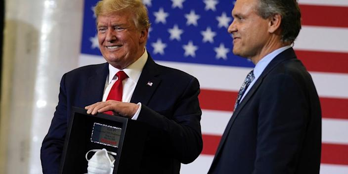 Honeywell CEO Darius Adamczyk presents President Donald Trump with a framed N95 mask on May 5 in Phoenix.