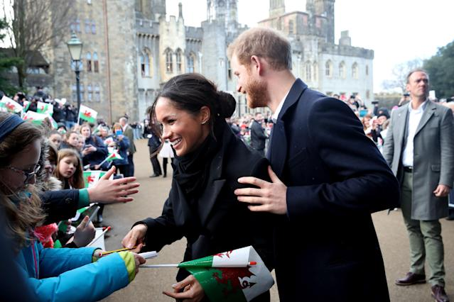 Prince Harry and Meghan Markle apologized to royal fans for their late arrival. (Photo: Getty Images)