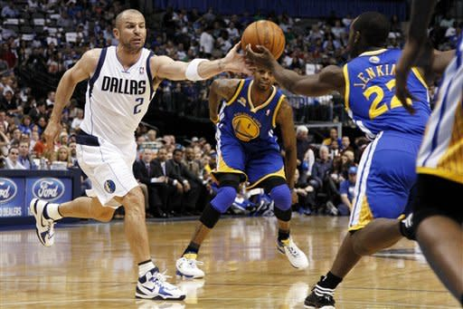 Dallas Mavericks' Jason Kidd (2) and Golden State Warriors' Charles Jenkins (22) reach out for a loose ball as Dorell Wright (1) watches in the first half of an NBA basketball game Friday, April 20, 2012, in Dallas. (AP Photo/Tony Gutierrez)