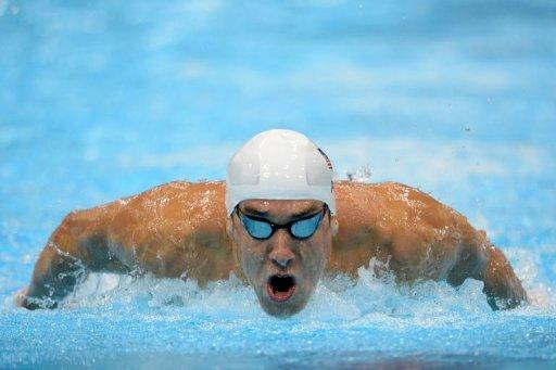 US swimmer Michael Phelps competes in the men's 400m individual medley heats