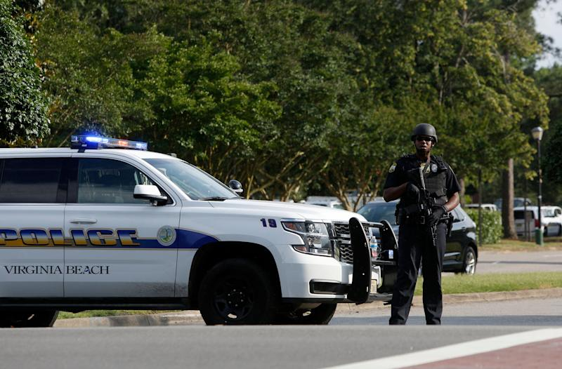 A police officer blocks an entrance to the Virginia Beach Municipal Center off of Princess Anne Road following a shooting May 31, 2019 in Virginia Beach, Va. (Photo: Kaitlin McKeown/The Virginian-Pilot via AP)